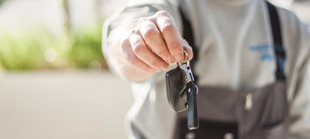 Photo of man handing over keys